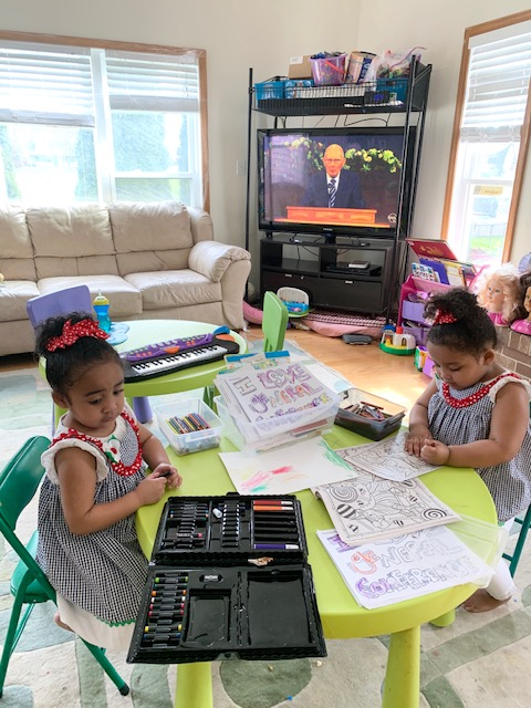 """4-year old twins, Gianna """"Gigi"""" and Gabriella """"Gabby"""" Del Valle of the Naperville 6th Ward, Naperville Illinois Stake, color in their general conference Packets during the Sunday morning session of the 190th Annual General Conference on April 5, 2020."""