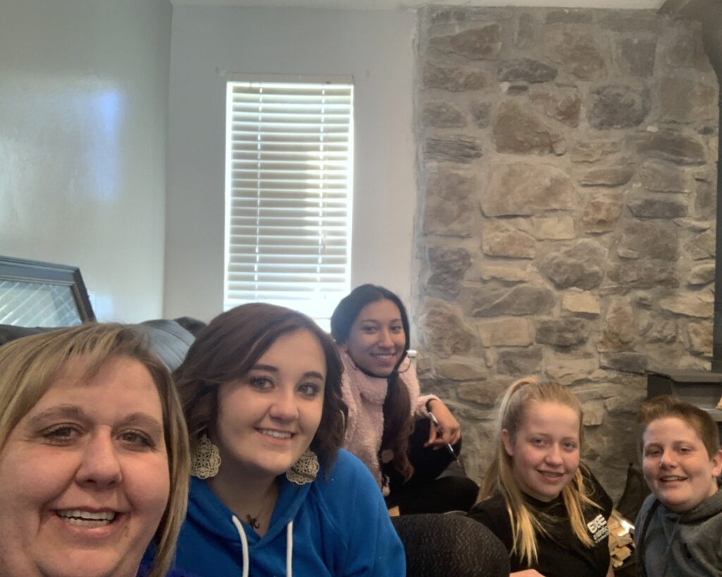 The Edelman family — Amber, Kayla, Milena, Allie and Turner — of the Corinne 1st Ward, Brigham City Utah West Stake, gather for the Saturday morning session of the 190th Annual General Conference on April 4, 2020.