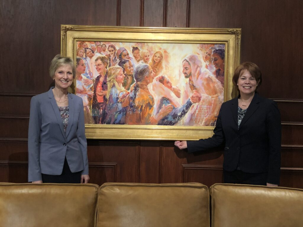 President Jean B. Bingham and Sister Sharon Eubank pose for a photo with the backdrop for the filming of their address for the 2020 Women's Conference digital event in Provo, Utah.