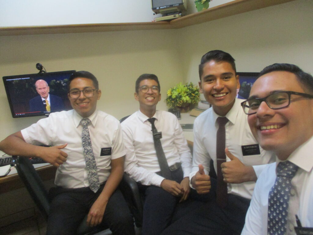"From left, Elder Coca (La Paz, Bolivia), Elder Marques (São Paulo, Brazil), Elder Robles (Cochabamba, Bolívia) and Elder Cano (Guatemala City, Guatemala) pose during the Saturday morning session of the 190th Annual General Conference on April 4, 2020. These missionaries are serving in the Castanheira Ward, Cabanagem Stake, in Belém, Pará, Brazil. Elder Marques wrote: ""I was looking for personal revelation for deep questions I have about the difficulties I am facing. It is wonderful how the Lord loves us and knows us. As the speakers talked, I could feel the Spirit illuminating my mind, and I realized my prayers had already been answered in the morning session. ""I know that the Lord knows us individually and He is eager to reveal His will to us. We can be sure of that during general conference."""