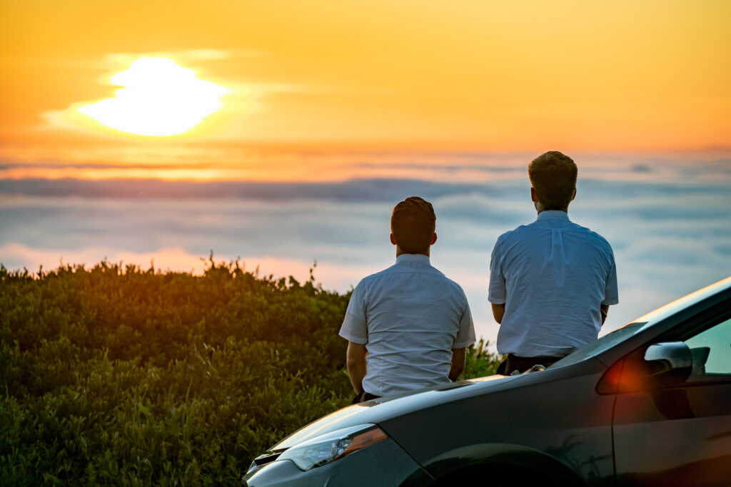 During COVID-19 pandemic, Elder Day and Elder Judd of the California San Clemente Mission take a moment to enjoy the beauty of a Sunset, from a hill and above a coastal fog bank on April 26, 2020.