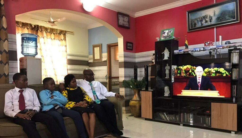 """Elder Isaac Morrison and his wife, Hannah, and their children, Kelvin and Gilbert, of the Ashaiman Ghana Stake, watch the Sunday afternoon session of the 190th Annual General Conference on April 5, 2020. Victor B. Ukorebi wrote, """"We have felt the Spirit so powerfully in this conference in our home than ever. We responded to President Nelson's invitation six months ago to prepare by studying the First Vision. This has contributed to our experience of a memorable and unforgettable conference weekend. We are grateful to be led by a prophet of God."""""""