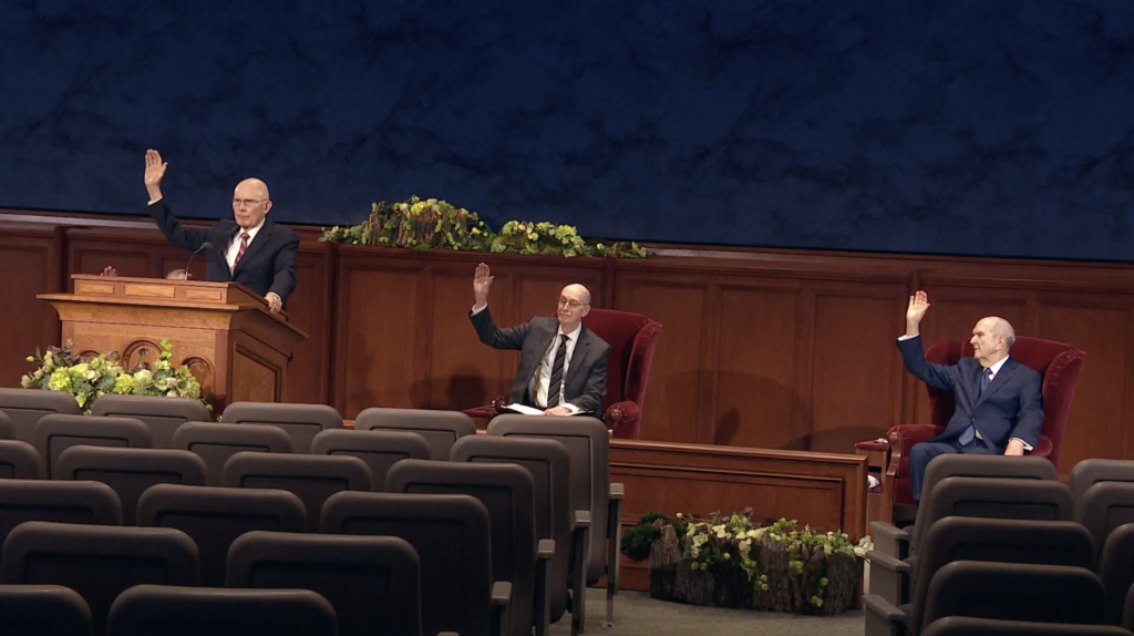 President Dallin H. Oaks, President Henry B. Eyring and President Russell M. Nelson give a sustaining vote during the sustaining of Church leaders and officers in the Saturday afternoon session of the 190th Annual General Conference on April 4, 2020.