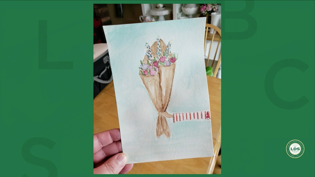 In a Tuesday, April 21, 2020, devotional broadcast for LDS Business College, Sister Alynda Kusch shares a photo of a watercolor painting her daughter created to send to a friend during the COVID-19 pandemic.