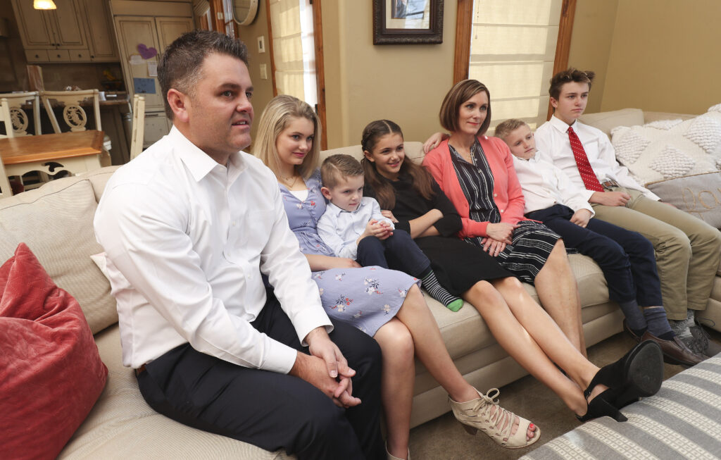 Tyler and Sheree Godfrey watch the 190th Annual General Conference of The Church of Jesus Christ of Latter-day Saints with their children Maddy, Boston, Gracie, Noah and T.J. from their home in Holladay, Utah, on Saturday, April 4, 2020.