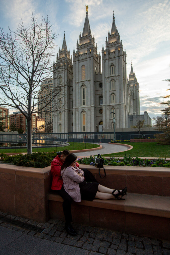 Mahonri J. Sanchez, of Orem, and Nancy Chairez, of Provo, pray together as they watch the evening session of the 190th Annual General Conference at Temple Square in Salt Lake City on Saturday, April 4, 2020. Sanchez planned to take Chairez to the Conference Center to attend conference together this year but had to cancel their plans due to the COVID-19 pandemic.