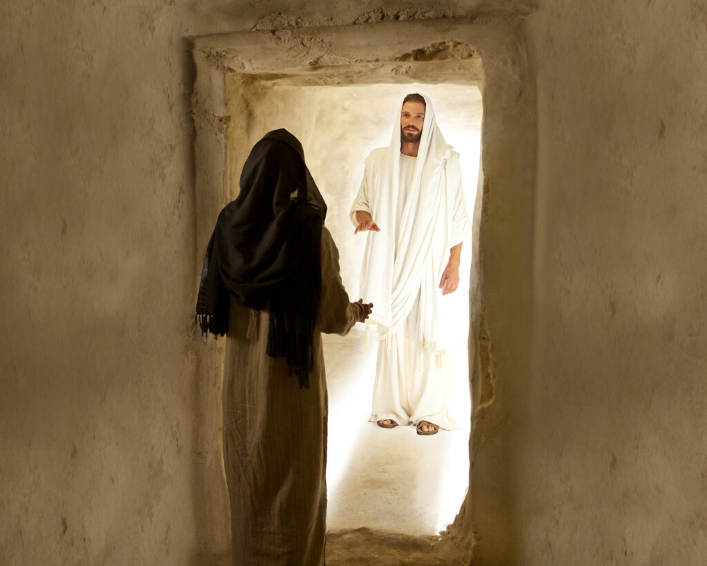 An image from the Bible Videos depicts Mary Magdalene speaking with Jesus Christ after His Resurrection.