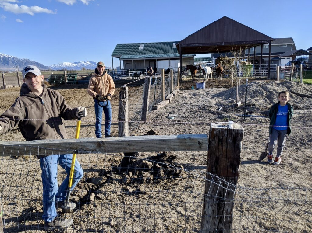 Left, Daniel Curtis, far back, Elder Alec Curtis, and right, Jacob Curtis work together on the family farm in Garland, Utah.