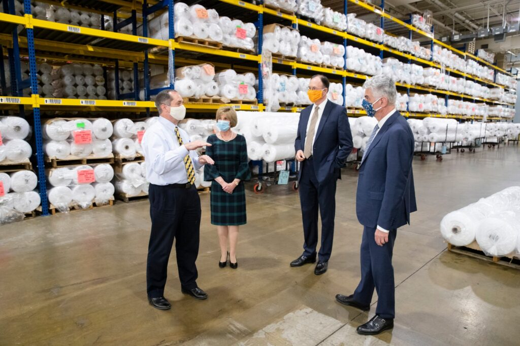 The Presiding Bishopric is given a tour of the Beehive Clothing facility in Salt Lake City, Utah, where employees are making surgical gowns for health care workers during the COVID-19 pandemic on Friday, May 15, 2020.