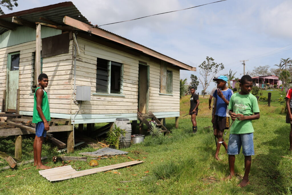 Members of the Nausori Fiji Stake work together to rebuild homes damaged by Cyclone Winston in February 2016.