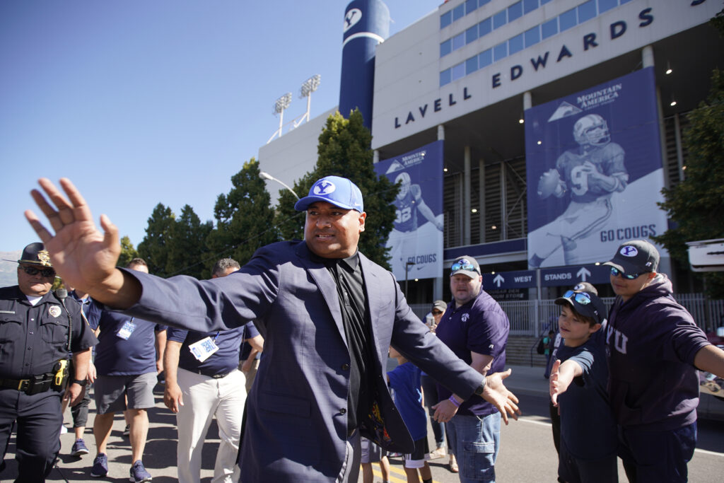 BYU head coach Kalani Sitake waves to fans as he arrives for a game against USC on Saturday, Sept. 14, 2019, in Provo, Utah.
