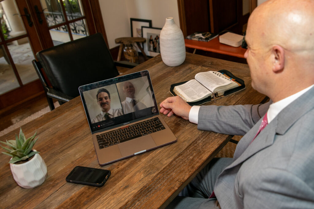 Bishop Barry Port of the Covenant Hills Ward in the Mission Viejo California Stake meets with his bishopric counselors via Zoom meetings from his home office. Many bishops have been continuing their duties using technology during the COVID-19 pandemic.