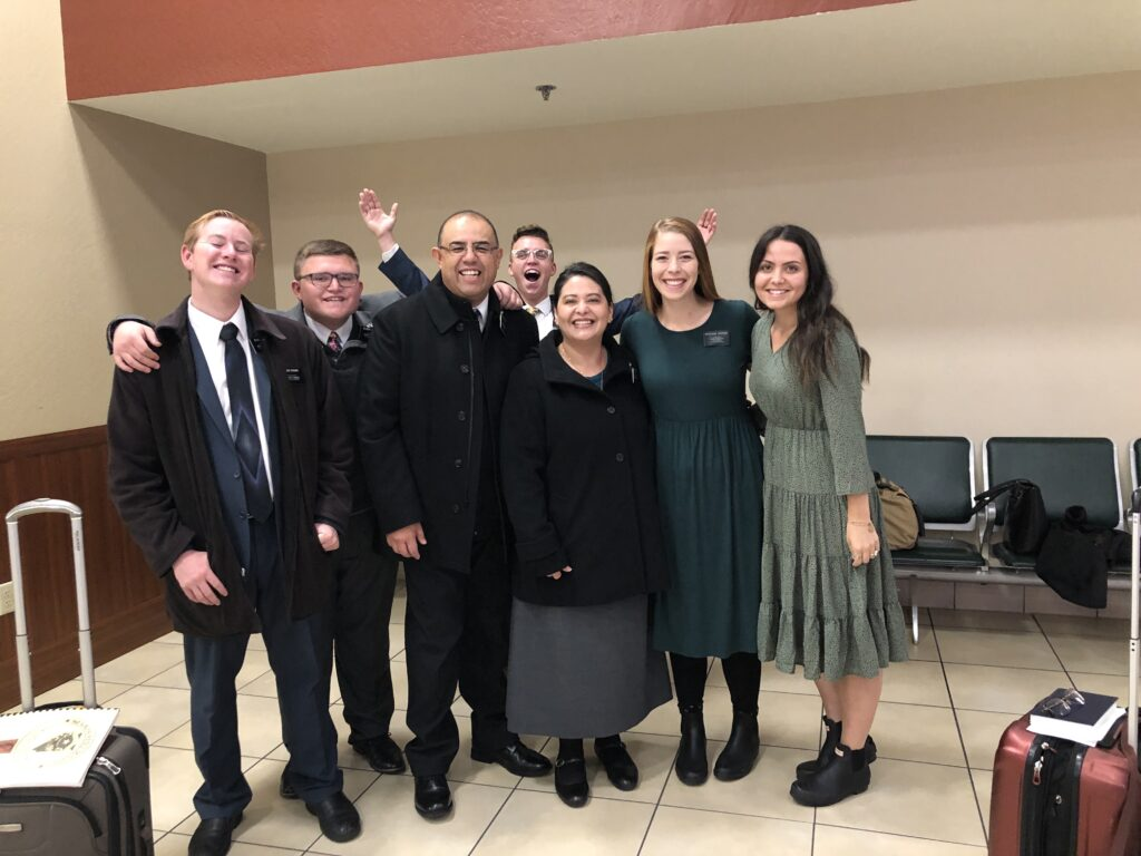 Elder Taylor G. Godoy, middle, and his wife, Sister Carol Godoy, are pictured with departing missionaries from the Nevada Reno Mission at the airport in November 2019. Elder Godoy is currently serving as president of the Nevada Reno Mission.