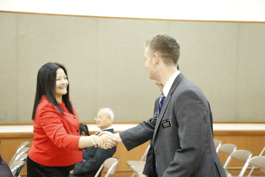 Sister Grace Teh, left, wife of Elder Michael John U. Teh, greets a missionary in Taiwan. Elder and Sister Teh presided over the Taiwan Taichung Mission from 2016 to 2018.