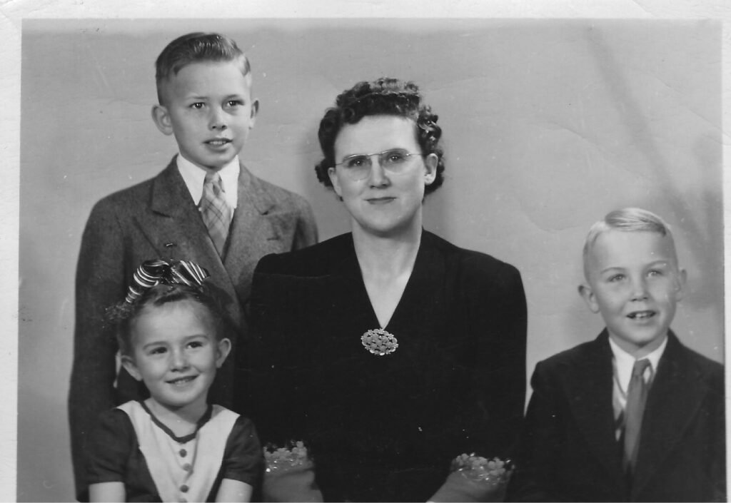 President Dallin H. Oaks with his mother, Stella, brother Merrill and sister Evelyn. President Oaks' father died when he was 7 years old, and his mother raised three children on her own.