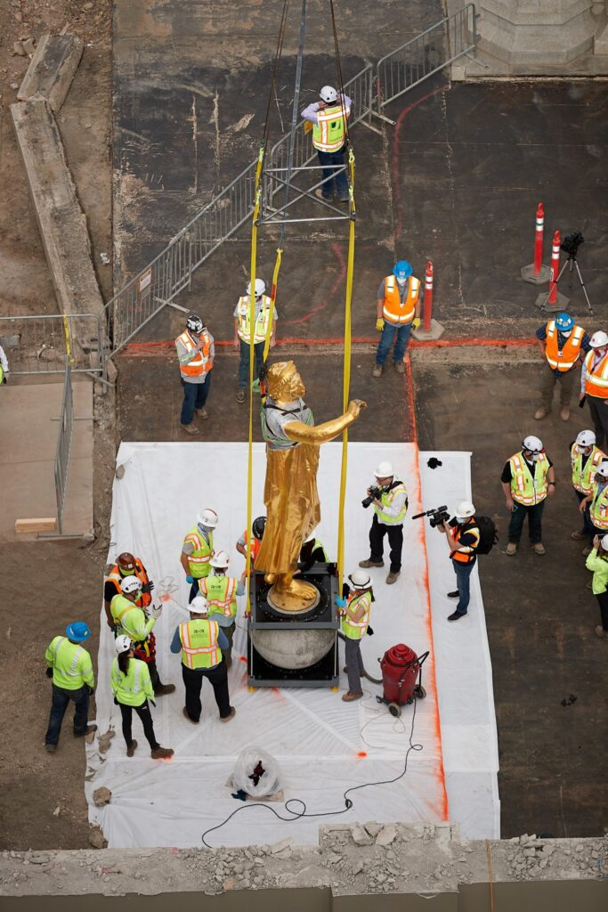 The angel Moroni and capstone touch down on the ground a part of the ongoing renovation of the Salt Lake Temple, May 18, 2020.