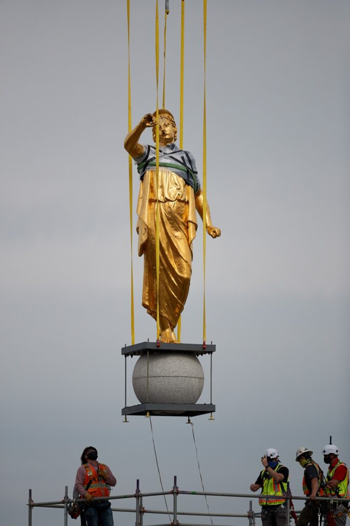 Construction workers gently remove the angel Moroni and capstone with a large crane as a part of the ongoing renovation of the Salt Lake Temple, May 18, 2020.