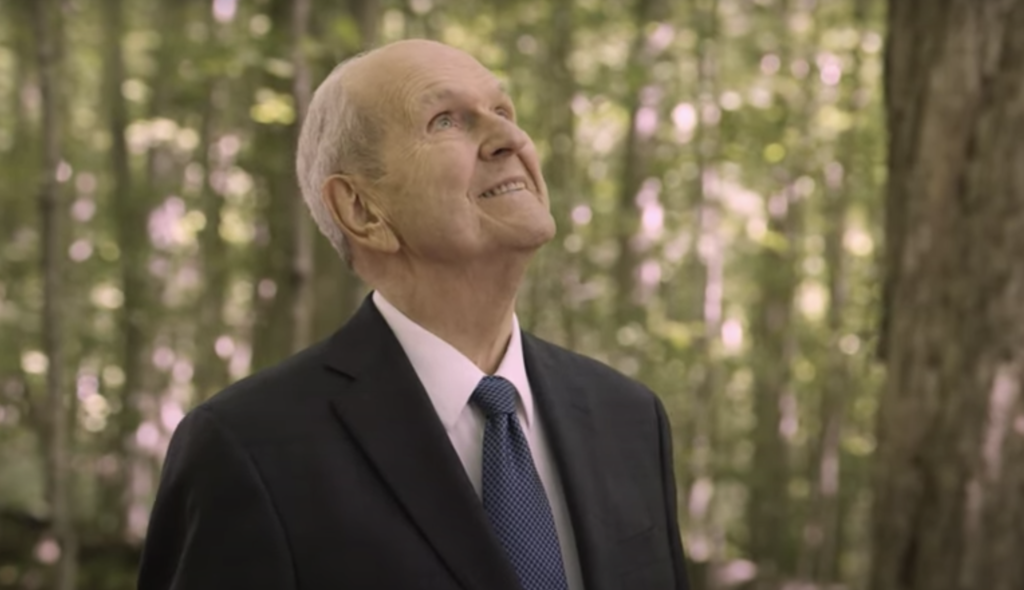 President Russell M. Nelson stands in the Sacred Grove in Palmayra, New York and looks up while filming the video announcing the new bicentennial proclamation of the Church.