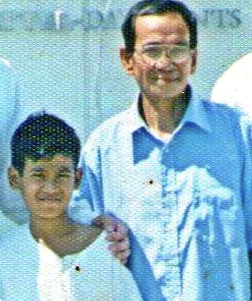 Elvin Laceda with his grandfather when Elvin was baptized at age 11 on Oct. 16, 2005, in Lubao, Pampanga, Philippines.