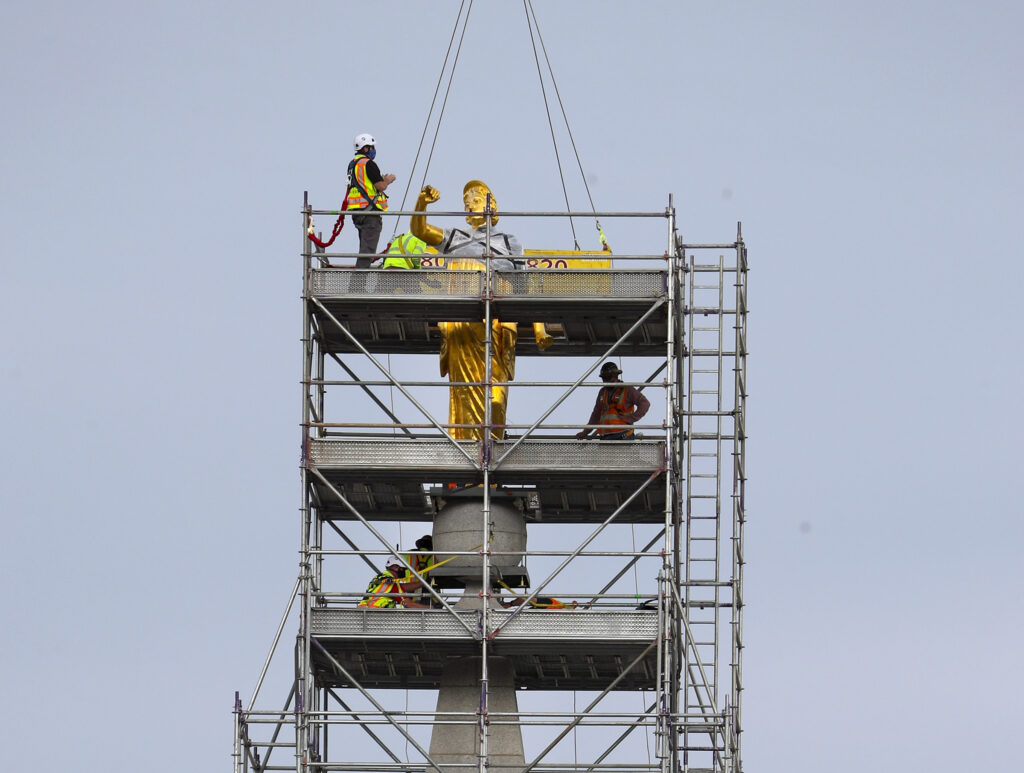 Crews prepare to temporarily remove the statue of the Angel Moroni from atop The Church of Jesus Christ of Latter-day Saints' Salt Lake Temple in Salt Lake City on Monday, May 18, 2020. The statue lost its trumpet during an earthquake on March 18. The temple is currently undergoing renovation.
