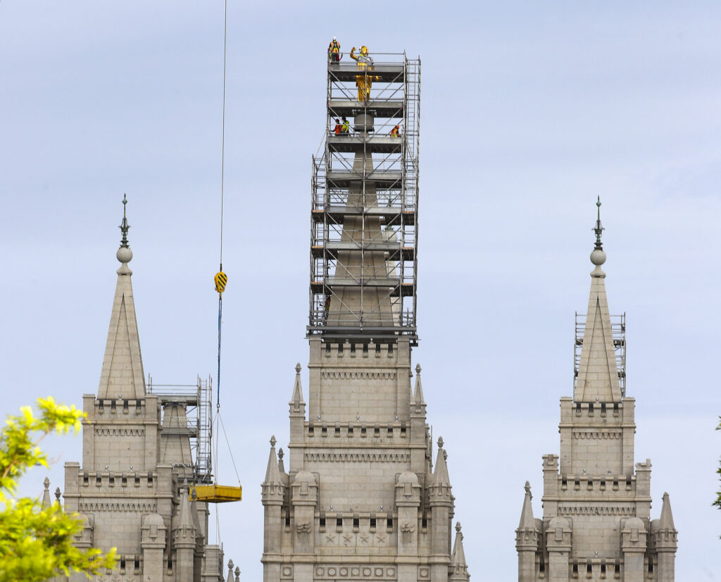 Crews prepare to temporarily remove the statue of the Angel Moroni from atop The Church of Jesus Christ of Latter-day Saints' Salt Lake Temple in Salt Lake City on Monday, May 18, 2020.The statue lost its trumpet during an earthquake on March 18. The temple is currently undergoing renovation.