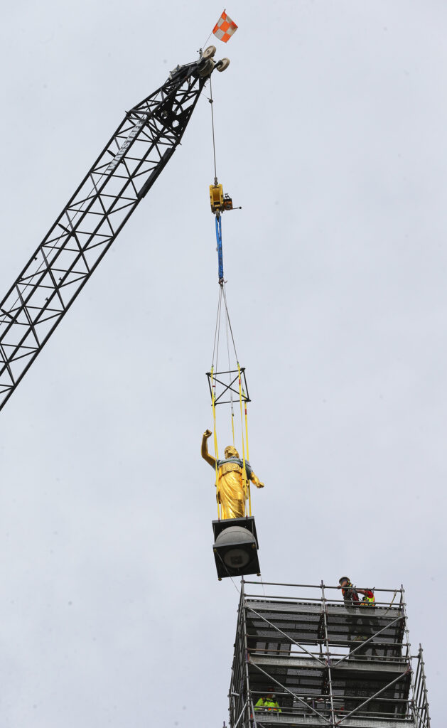 Workers from Jacobsen Construction remove the Angel Moroni statue from the Salt Lake Temple of The Church of Jesus Christ of Latter-day Saints in Salt Lake City on Monday, May 18, 2020.