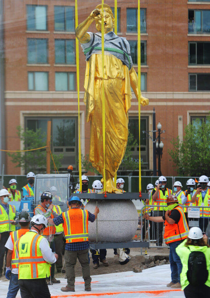 Workers from Jacobsen Construction carefully position the Angel Moroni statue as they remove it from the Salt Lake Temple of The Church of Jesus Christ of Latter-day Saints in Salt Lake City on Monday, May 18, 2020.