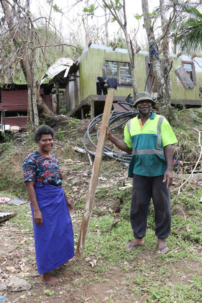 Unaisi Liku and Manoa Seavu of Nasautoka Village in Fiji stand in front of the walls of their home, destroyed by Cyclone Winston in February 2016. The couple and their four children climbed under the home to survive the storm.