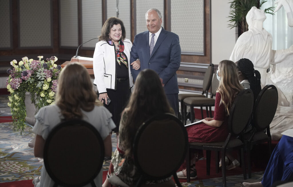 Elder Ronald A. Rasband of the Quorum of the Twelve Apostles, and his wife, Sister Melanie Rasband, talk with missionaries prior to a missionary broadcast at the Joseph Smith Memorial Building in Salt Lake City. The devotional was released on June 4, 2020.
