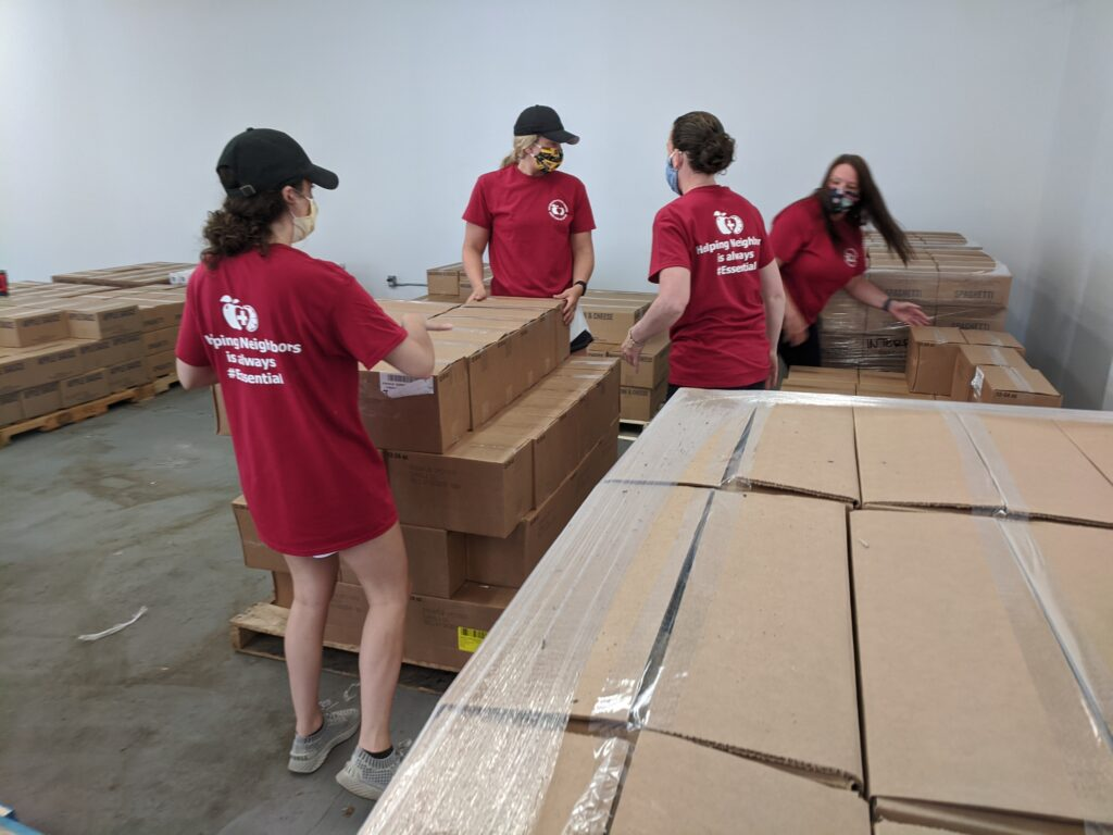 From left to right, Weymouth Food Pantry volunteers Samantha Coyle, Jessica Coyle, Janie Salani and Barbara Sargeant unload boxes of nonperishable food into a warehouse in Rockland, Massachusetts, on Thursday, June 4, to be distributed to South Shore residents in need. The Church of Jesus Christ of Latter-day Saints donated 41,695 pounds of nonperishable food to Interfaith Social Services and Weymouth Food Pantry.