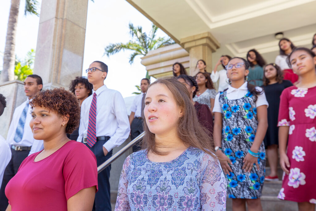 Youth in the Caribbean participate in a pre-recorded musical number on the steps of the Santo Domingo Dominican Republic Temple as part of a virtual FSY conference held June 22-26, 2020.