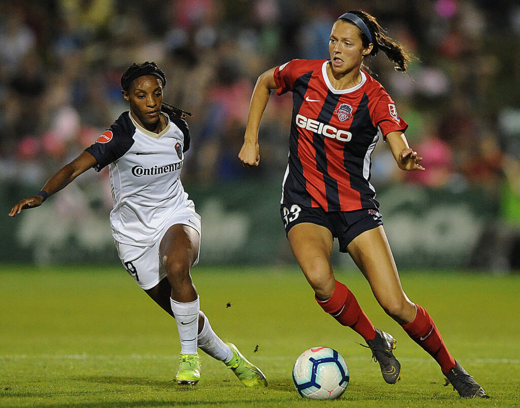 Ashley Hatch darts around the North Carolina Courage's Crystal Dunn during NWSL action. Hatch played college soccer at BYU.