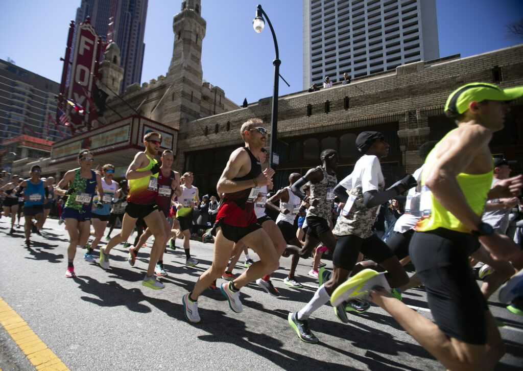 Jared Ward (center, in black) competes with the lead pack of men's runners during the US Olympic Marathon Trials in Atlanta Ga., Saturday, February 29, 2020.