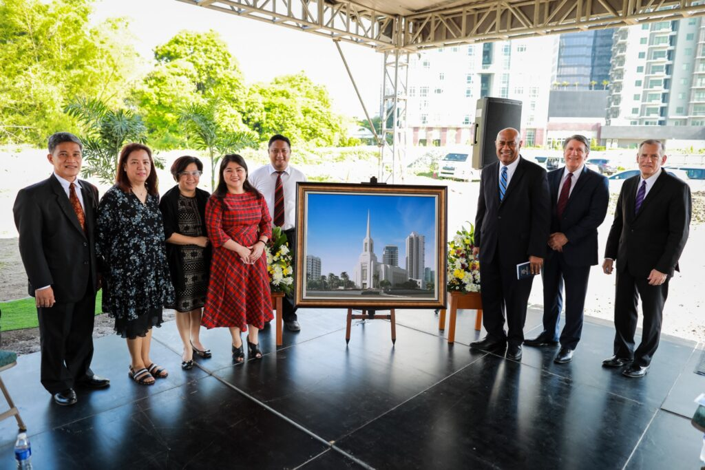 The Philippines Area presidency, right, and Church members pose for a photo with the rendering of the Alabang Philippines Temple during the groundbreaking service on June 4, 2020.
