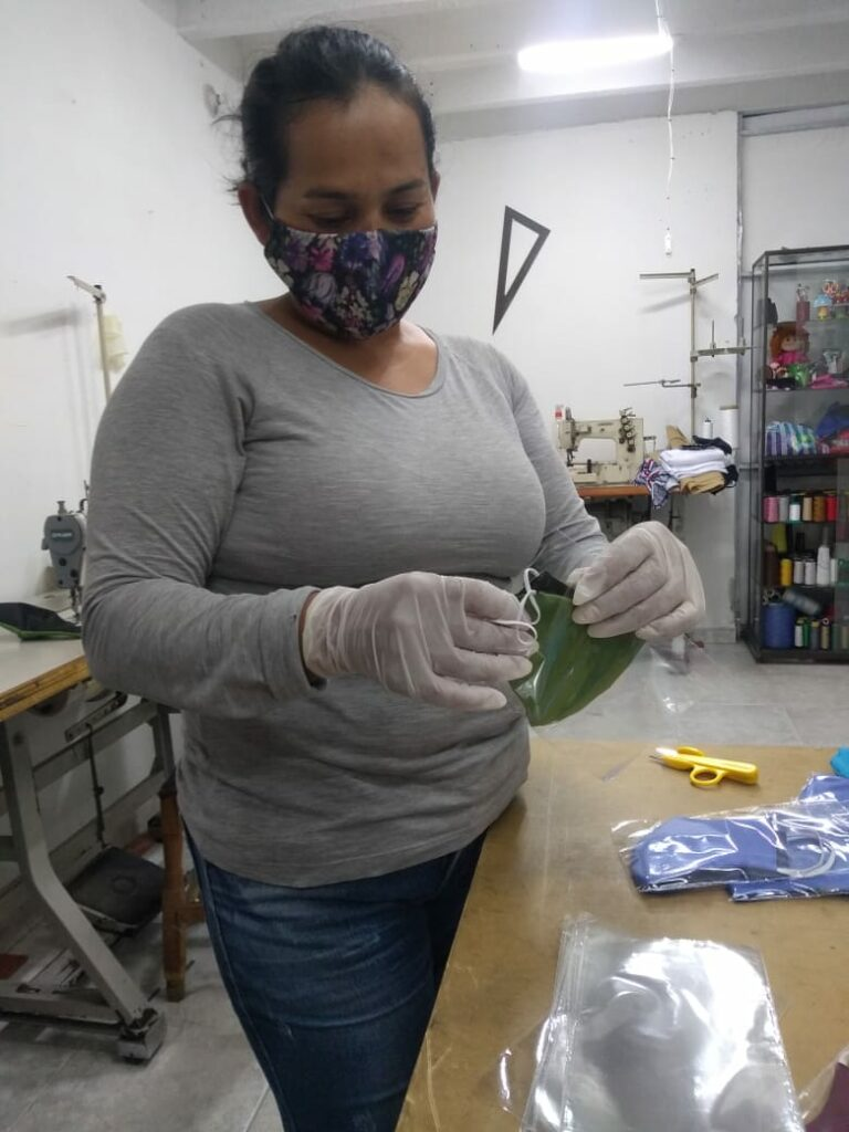 A Relief Society sister from Bucaramanga, Colombia, crafts face masks as part of a local service project.