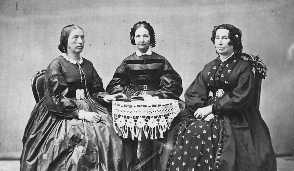 Studio portrait by Savage and Ottinger, circa 1865–1873. Left to right: Elizabeth A. Howard, Eliza R. Snow, and Hannah T. King.