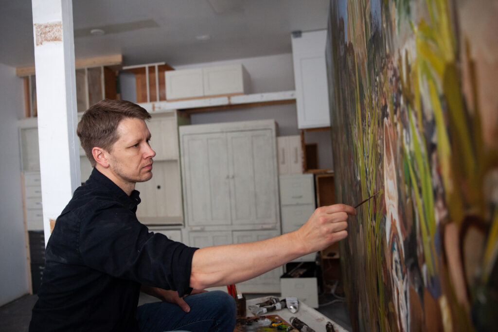 Latter-day Saint artist J. Kirk Richards paints in his studio in Redmond, Utah. Richards' work has been featured in previous Church History Museum International Art Competition and Exhibitions.