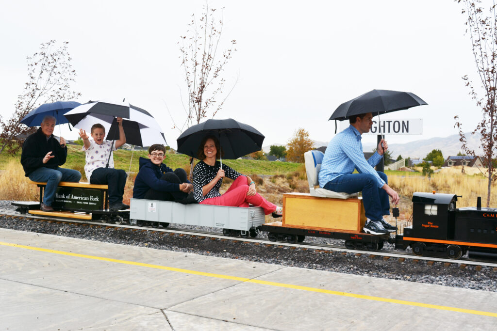Brittany Beattie rides a small train with her father, brother and nephews.