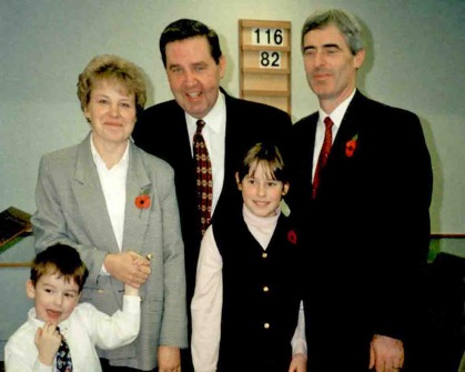 Elder Jeffrey R. Holland is pictured with Solihull residents Pat and Paul Wilkinson and two of their children, Peter and Catherine, following the dedication of the Solihull Ward Chapel on Nov. 11, 1995.