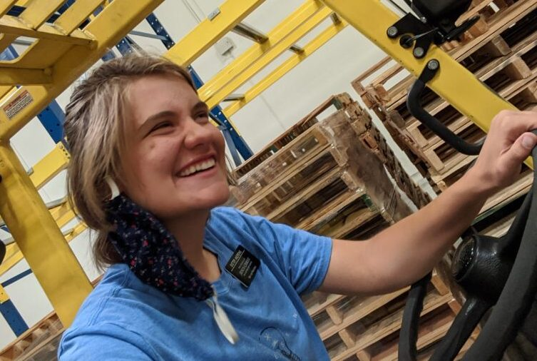 Sister Bekki Andrews smiles on a forklift at the Bishops' Central Storehouse in Mira Loma, California, on July 29, 2020. Learning to drive a forklift has been one of Sister Andrews' biggest accomplishments of her service mission.