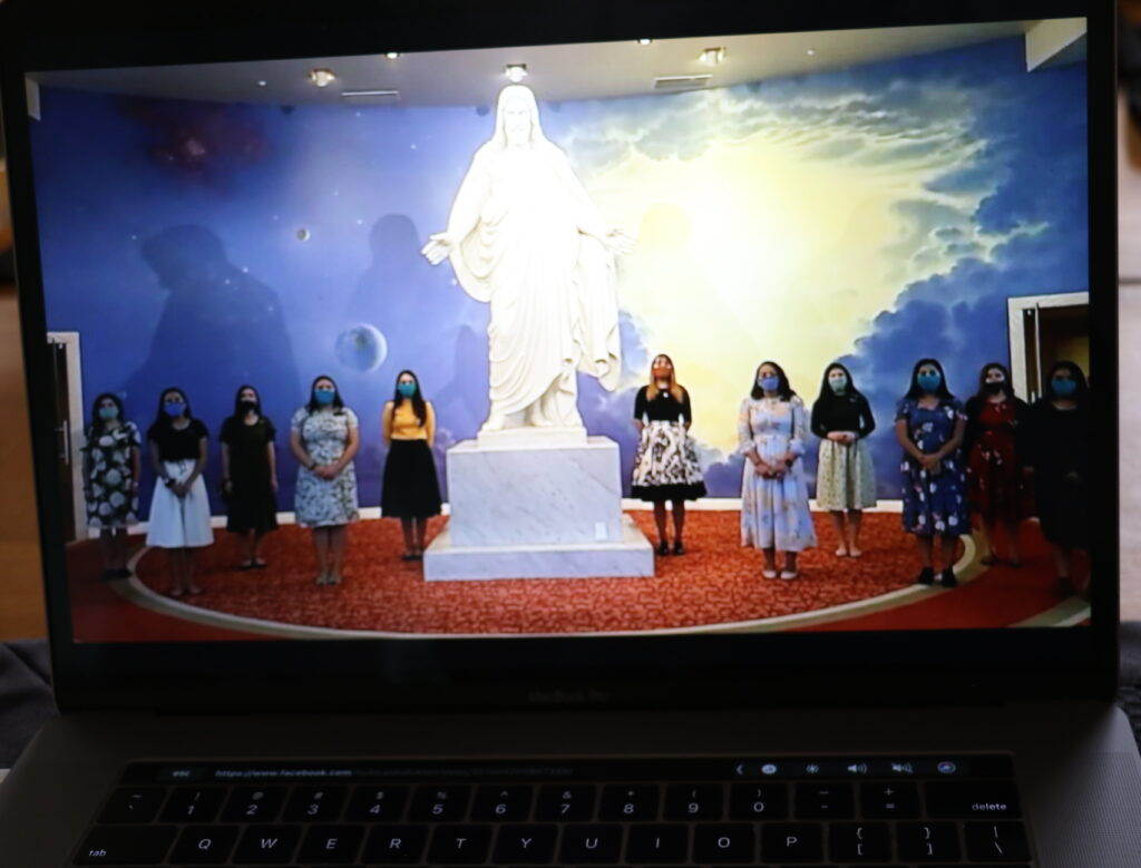 A computer shows a choir of missionaries assigned to the Mexico City Mexico Temple Visitors' Center sing at the conclusion of a virtual tour of the center. Center directors hope to resume limited public tours of the facility by early September, 2020.