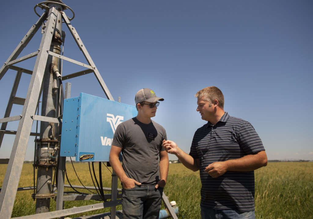 Elder Garrett Mill, left, talks with his supervisor, David Neilsen, during his shift on Saturday, July 18, 2020, at Idaho Falls Crops south of Idaho Falls, Idaho.