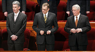 Presiding Bishopric Bishop Gary E. Stevenson, Bishop Gerald Causse and Bishop Dean M. Davies sing during a congregational hymn during the 182nd Annual General Conference for The Church of Jesus Christ of Latter-day Saints in Salt Lake City Sunday, April 1, 2012.