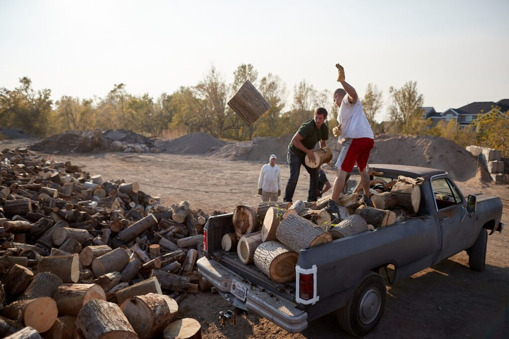 A group of volunteers from a local congregation of The Church of Jesus Christ of Latter-day Saints in Kaysville, Utah, throw freshly cut wood onto a large pile on Thursday, September 24, 2020. In response to Navajo residents and leaders' expressed need for firewood, piles of wood from storm-ridden areas were collected and dropped-off at 42 Church-owned properties as well as local entities throughout northern Utah.