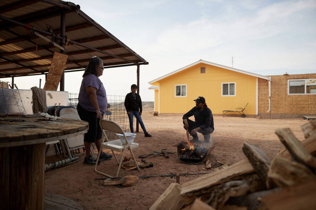 Ana Vigil, a Navajo Nation resident from Montezuma Creek, Utah, talks with Pete Sands, from Utah Navajo Health System, after receiving donated firewood on Saturday, September 26, 2020. In an interview with Church Newsroom, Sands explained that many of the Navajo Nation's residents will use the firewood to cook food and heat their homes.