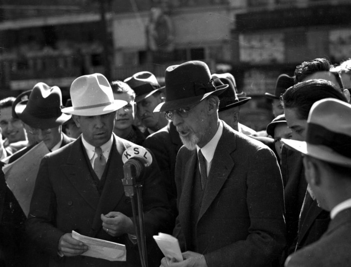 George Albert Smith, President of the LDS Church addressing a radio audience and crowd gathered on a Salt Lake City street, May 10, 1937. He was speaking on the nearly completed Golden Gate Bridge in California. (Utah State Historical Society)