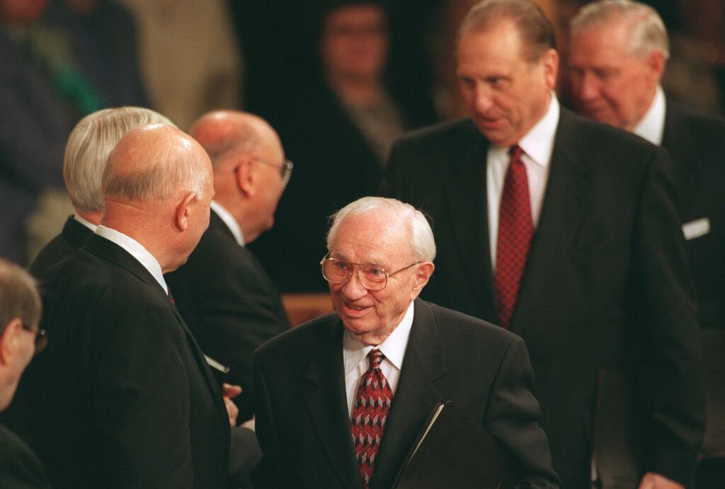 President Gordon B. Hinckley walks into the final session of conference Sunday afternoon with President Thomas S. Monson and President James E. Faust on April 4, 1999.