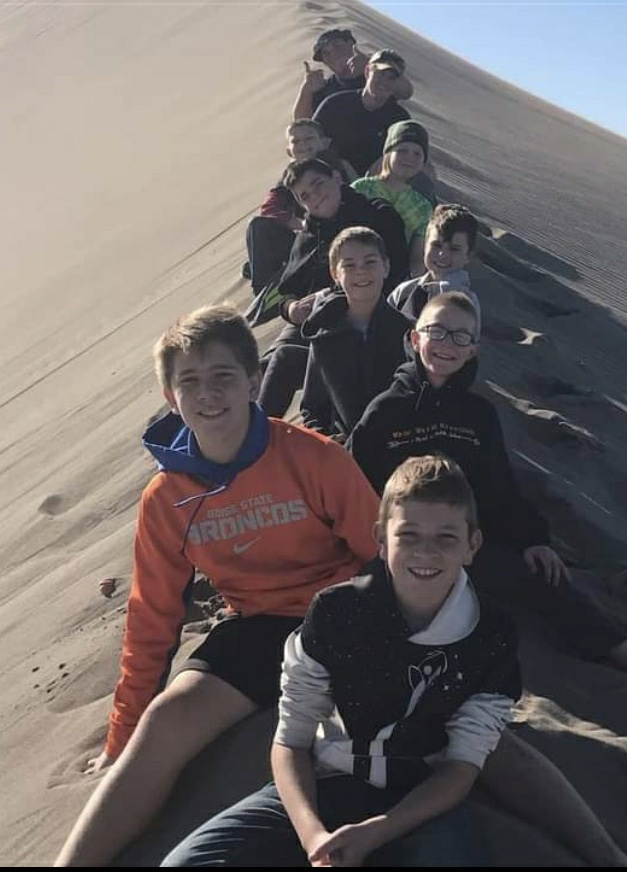 Members of the Meridian 12th Ward, Meridian Idaho Stake, enjoy a quorum activity at Idaho's Bruneau Sand Dunes. Activities have help unify the quorum.