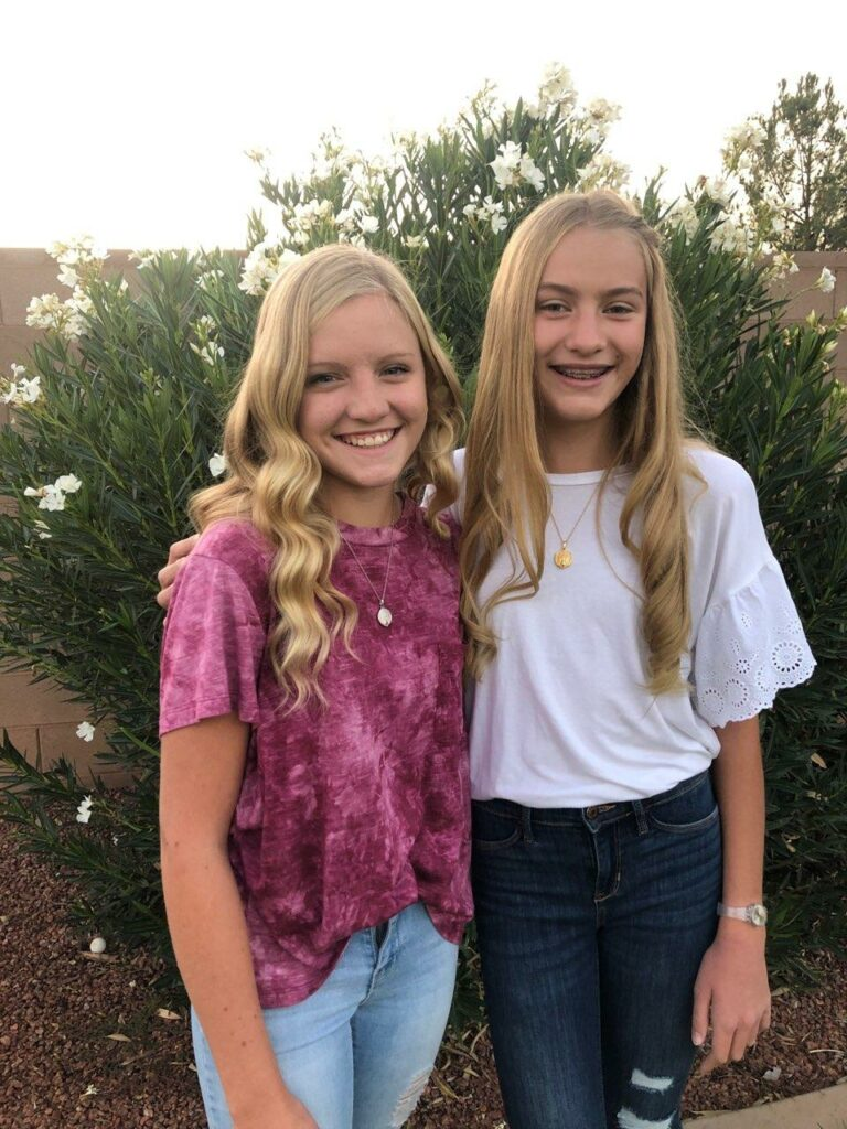 Brooklyn Boone, left, and Courtney Boone, right, pose for a picture together.