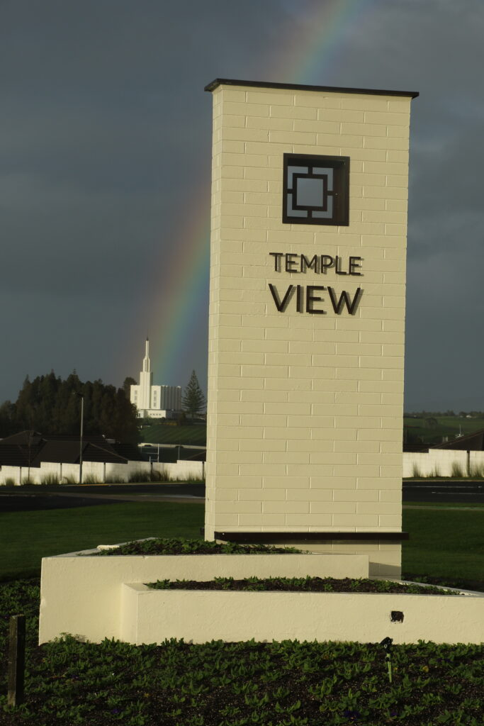 The Latter-day Saint community of Temple View, New Zealand, is located in the green hills below the Hamilton New Zealand Temple.